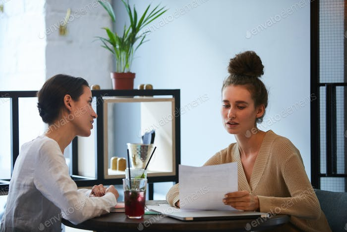 Discussing contract with colleague