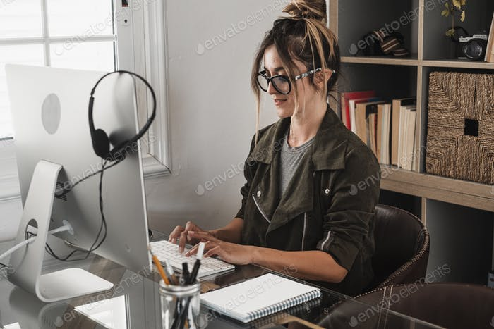 Young businesswoman write on laptop computer at home in smart working office job work