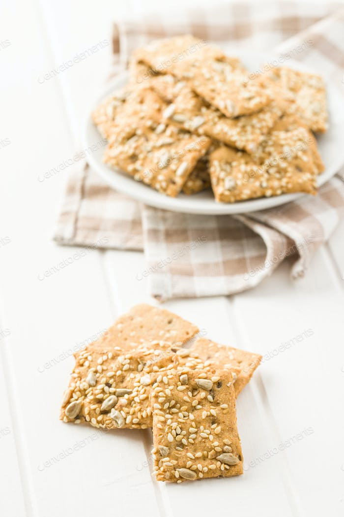 Salted crispy crackers with sesame and sunflower seeds