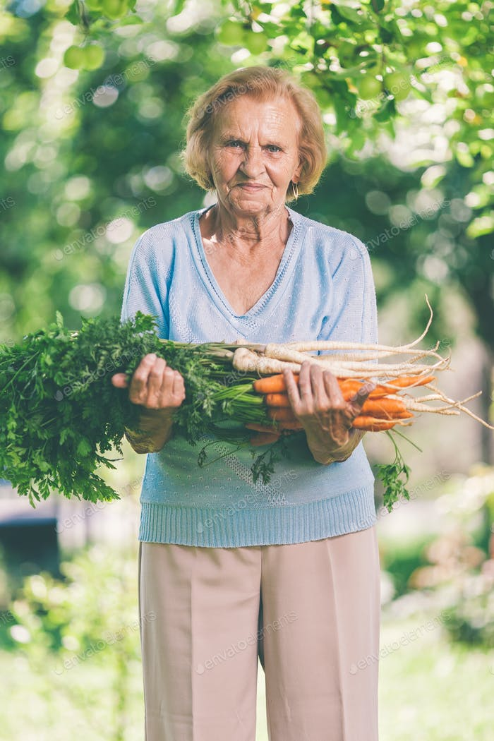 Senior woman with fresh crop from her garden