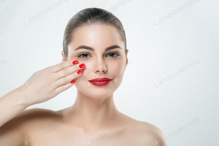 Red nails and lips model woman isolated on white. Color makeup