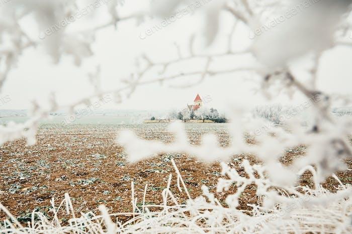 Small cemetery amid frozen landscape