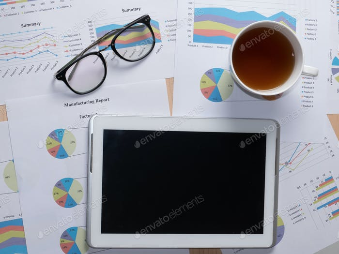 business report data paper with pen and tablet