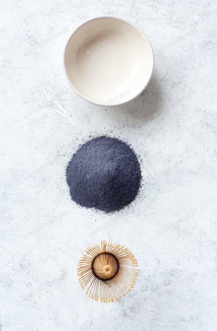 Butterfly pea blue matcha powder with wrisk
