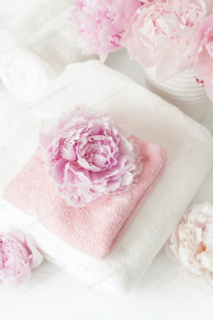 bath and spa with peony flowers towels