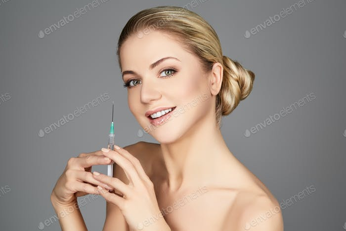 beautiful girl holding syringe