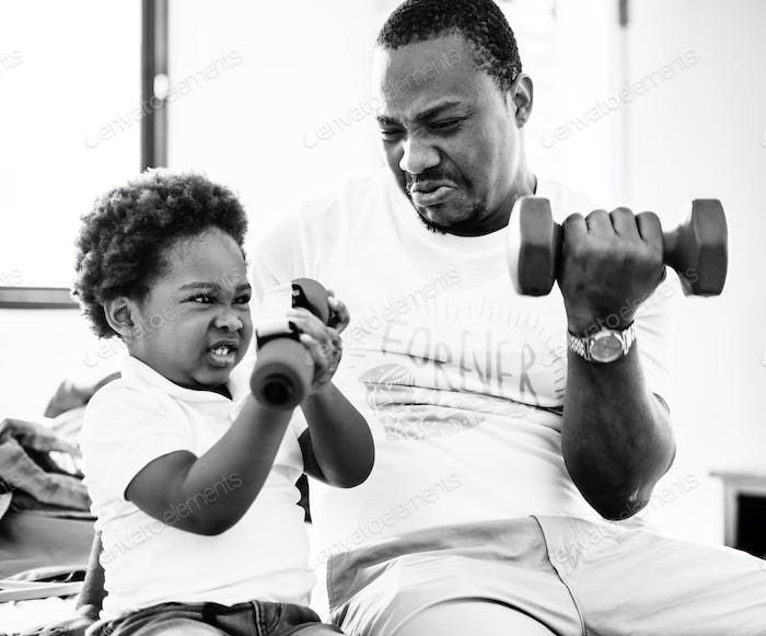 Grayscale of black family exercising