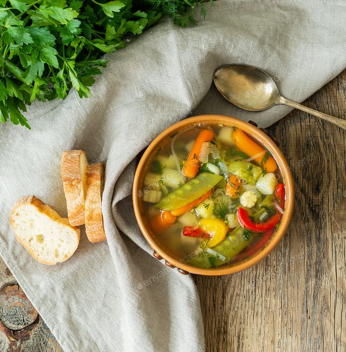 Bright spring vegetable dietary vegetarian soup. Top view