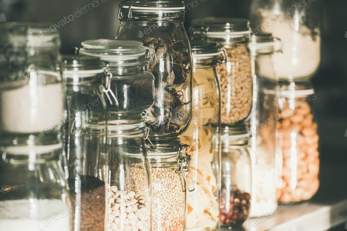 Grains, cereals, nuts, dry fruit, pasta in glass jars