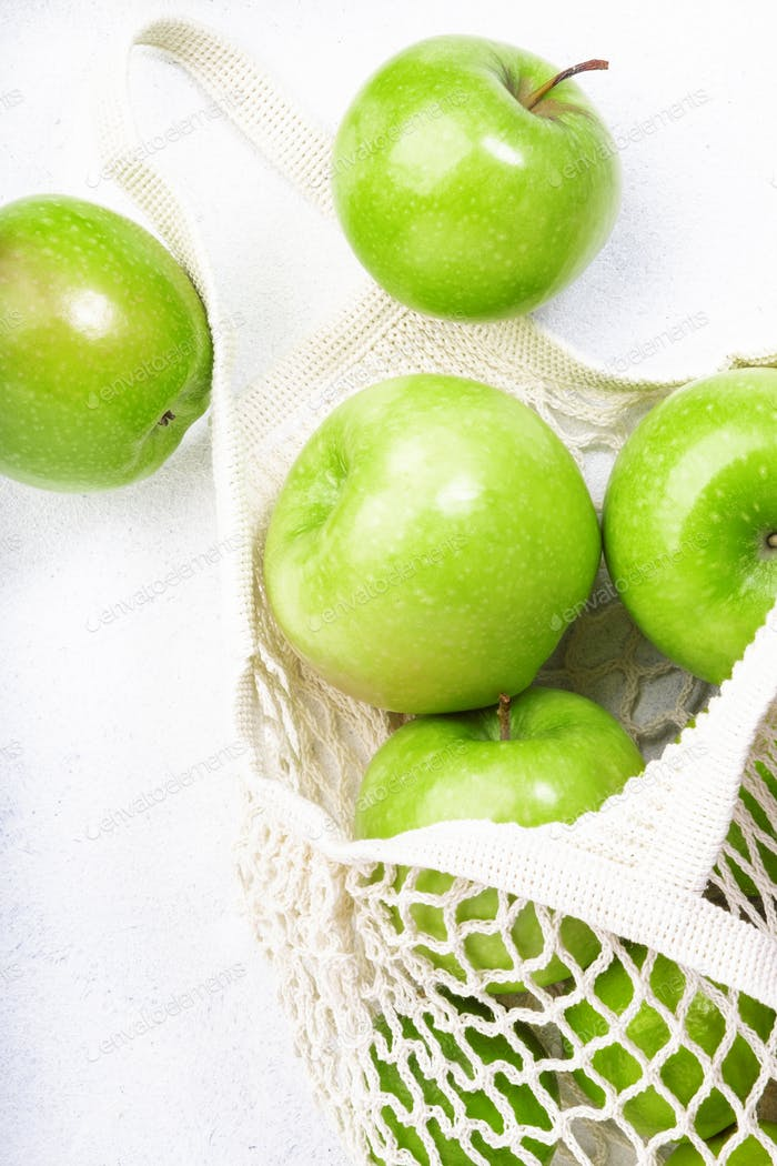 Organic green apples in reusable eco-friendly string mesh bag