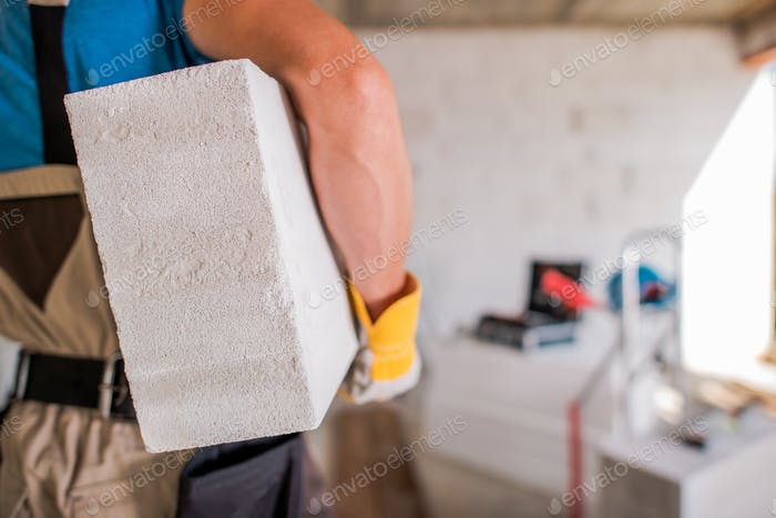 Contractor with Concrete Block