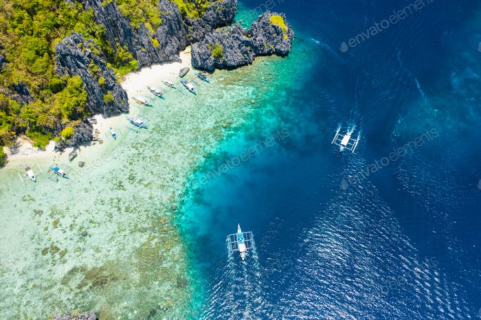 Shimizu Island, El Nido, Palawan, Philippines. Aerial drone view of a tiny tropical island with
