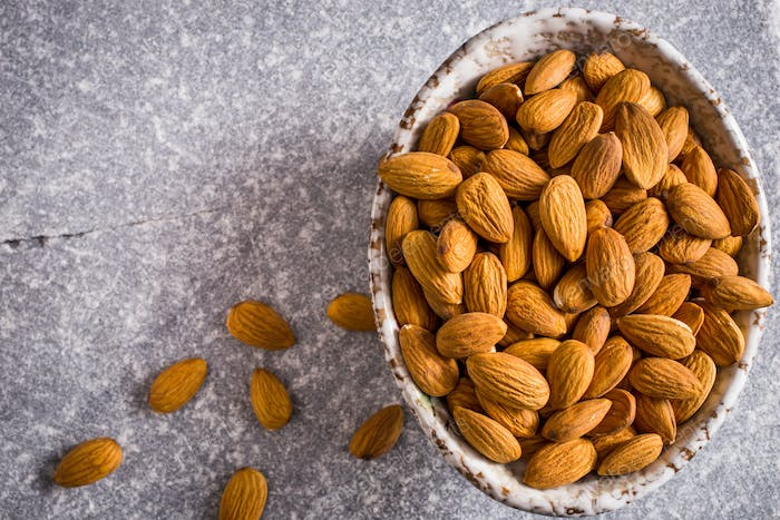 Bowl of almonds above
