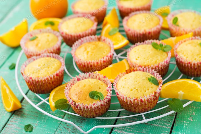 Tasty muffins with oranges and mint