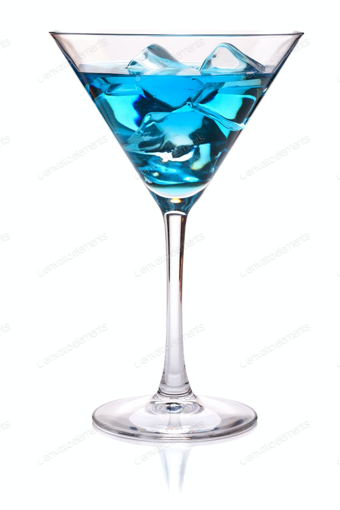 Blue tropical cocktail in martini glass