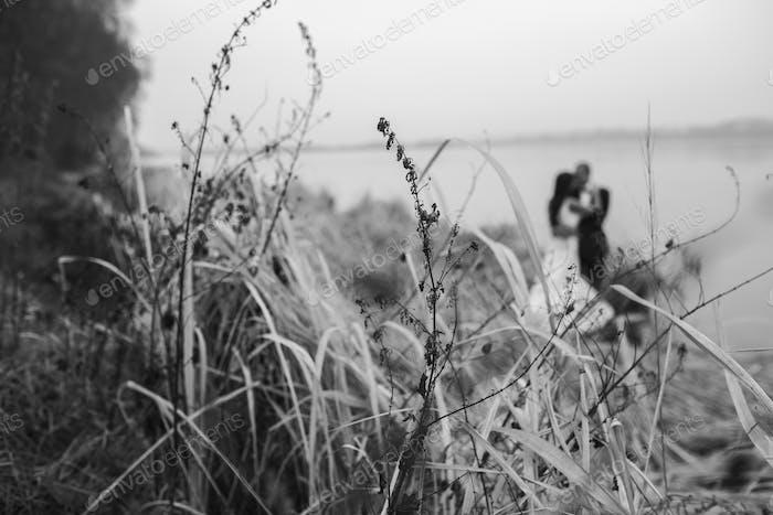 Wedding couple at the lake shore
