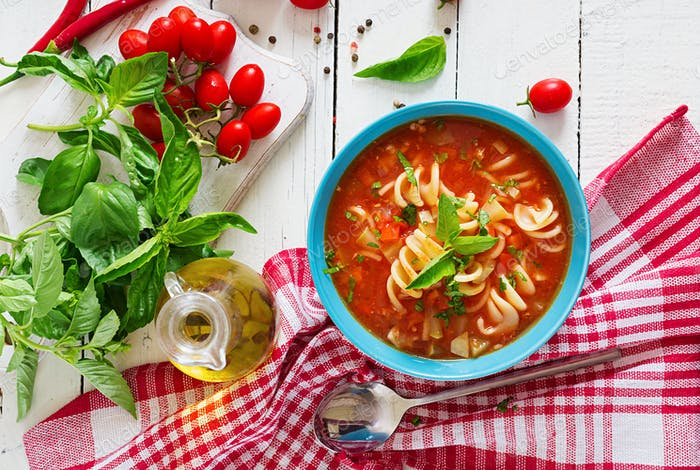 Minestrone, italian vegetable soup with pasta. Tomatoes soup. Vegan food. Top view. Flat lay.