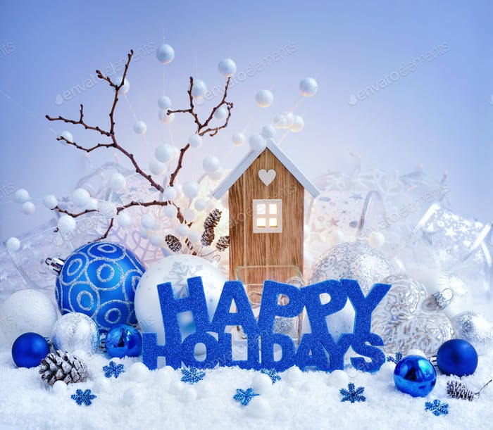 """Greeting """"Happy Holidays"""", decorative balls and toy house on a b"""