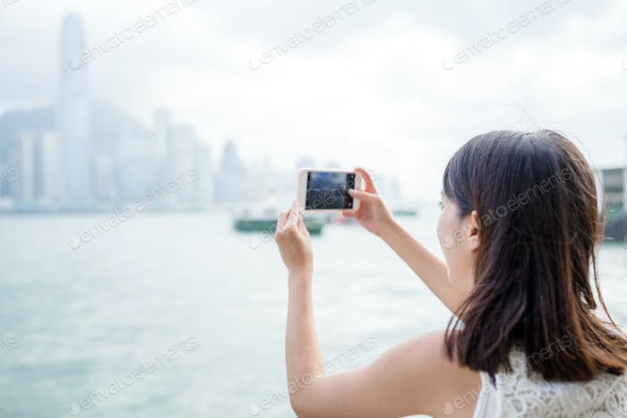 Woman taking photo on cellphone