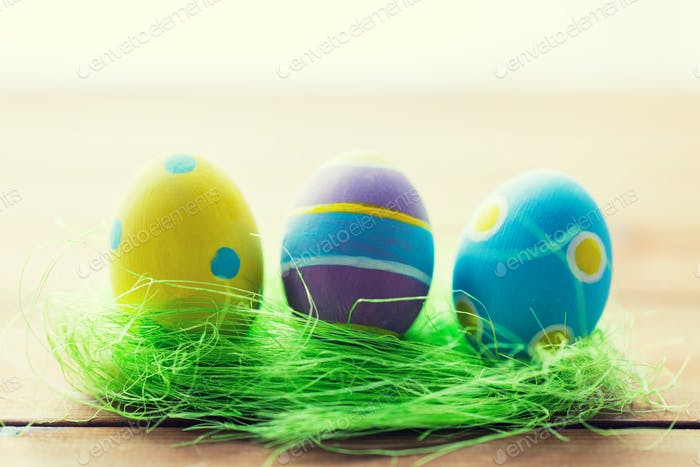close up of colored easter eggs and grass