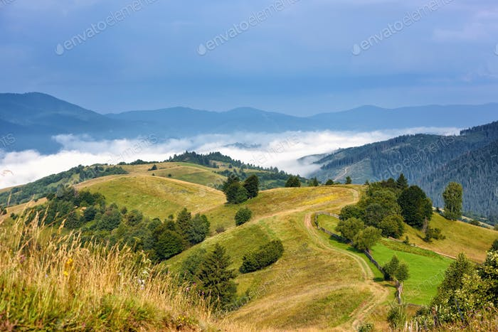 Beautiful rural mountain landscape with fog in the valley.  Carp