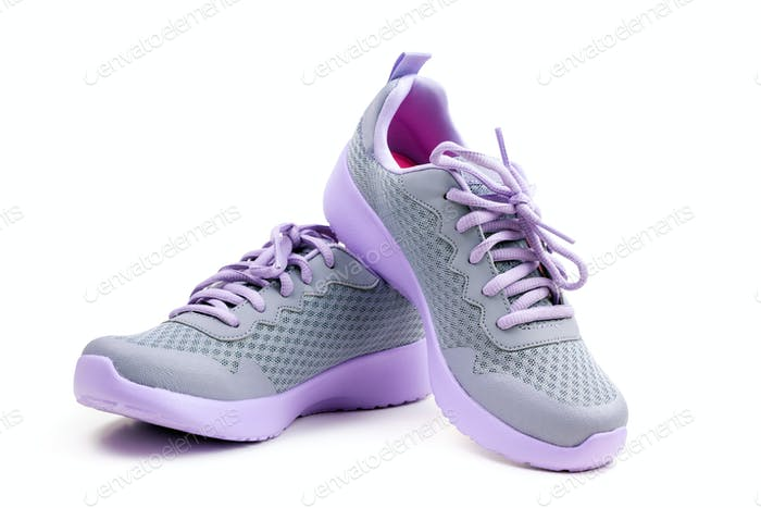 Unbranded purple running shoes on a white background