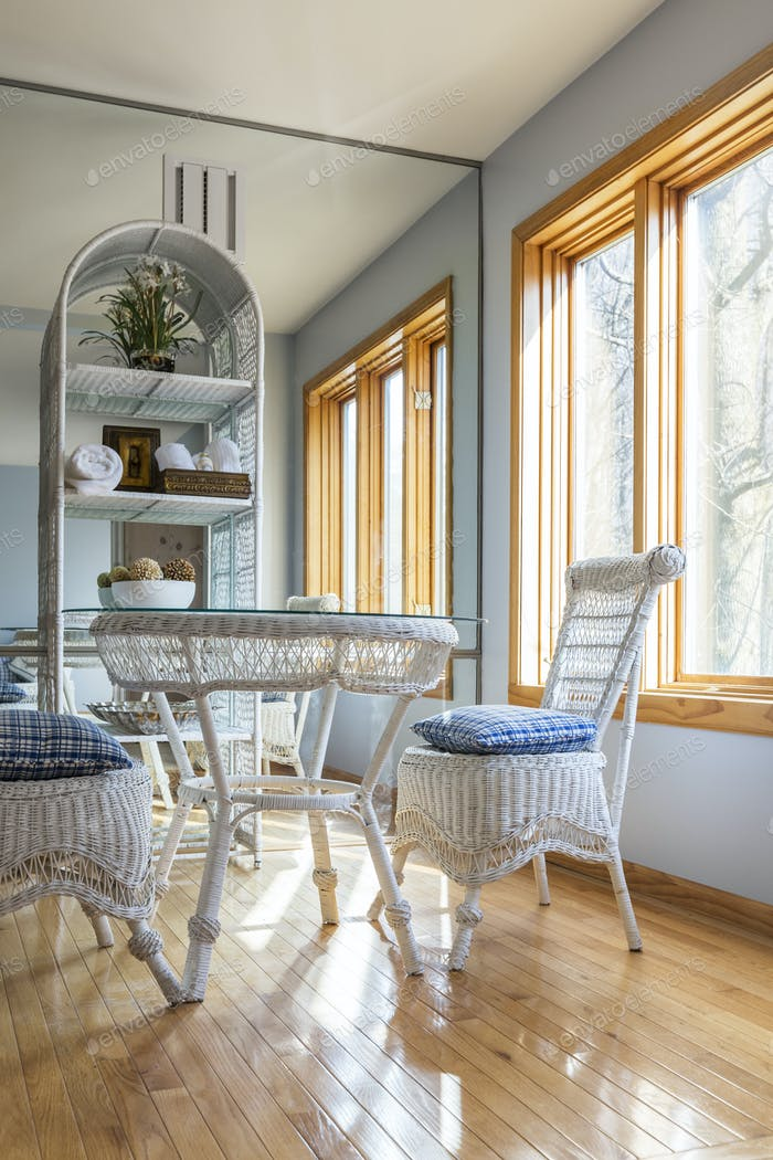 54688,Wicker chairs and table in dining room