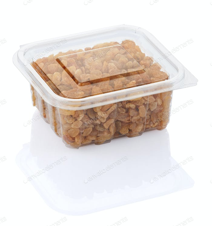 raisins in a transparent plastic container isolated on a white background with clipping path