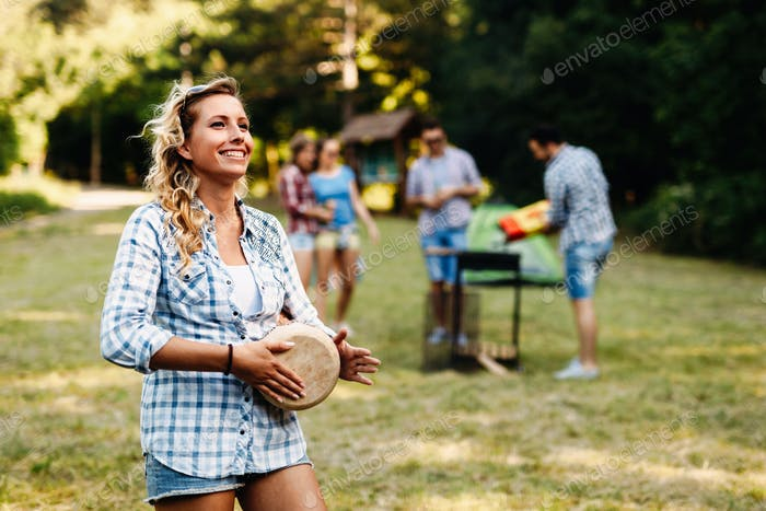 Happy woman enjoying camping
