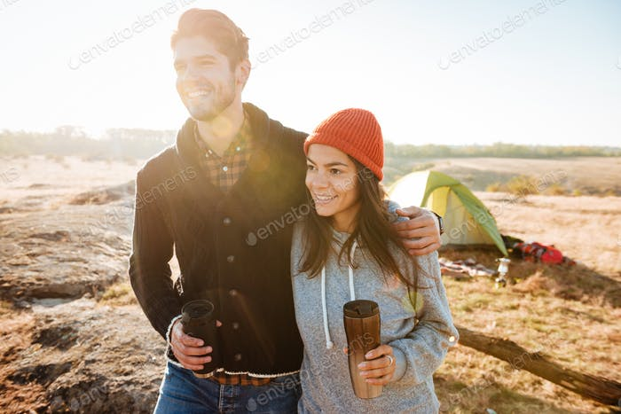 Couple standing near the tent