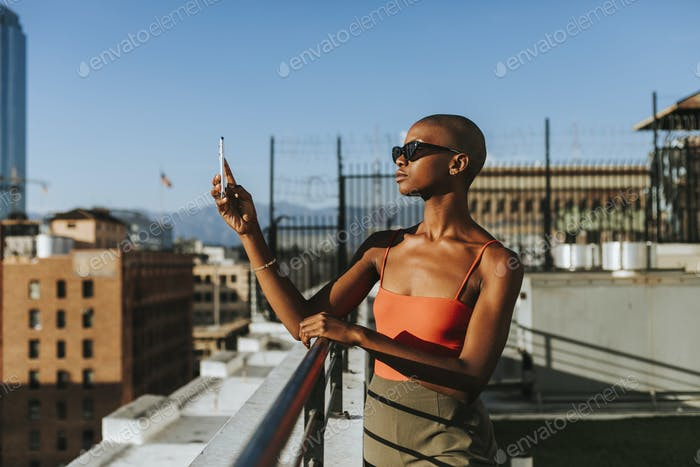 Woman taking a photo of Los Angeles
