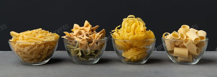 Different shape pasta with carbohydrates on black background