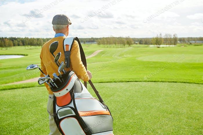 Golfer on play field