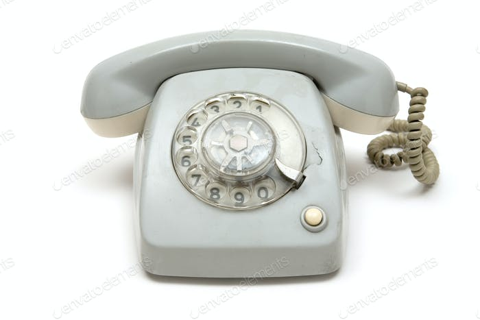 Grungy Old Telephone Isolated on a White Background