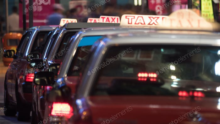 Taxi cars parked in row at night