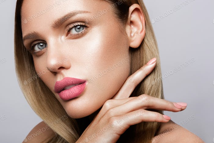 Thumbnail for Beautiful young model with pink lips. Nude manicure