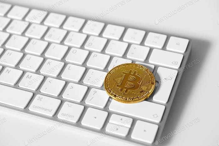 Bitcoin gold coin on keybord