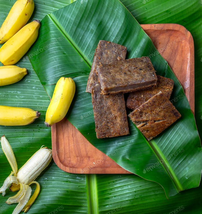 Easter Island Tahitian Polynesian banana pie pupping POE on wooden plate on banana palm tree leaves.