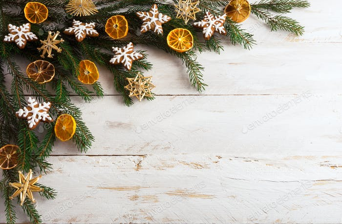 Christmas background with gingerbread cookies and dried orange s
