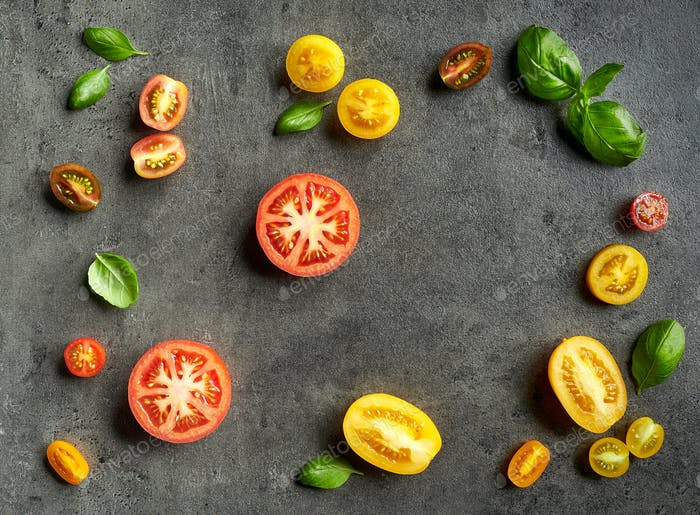 various colorful tomatoes and basil leaves