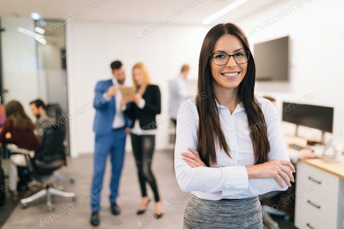 Portrait of successful beautiful businesswoman in office