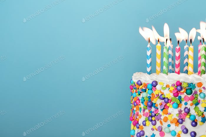 Colorful birthday cake with lots of candles