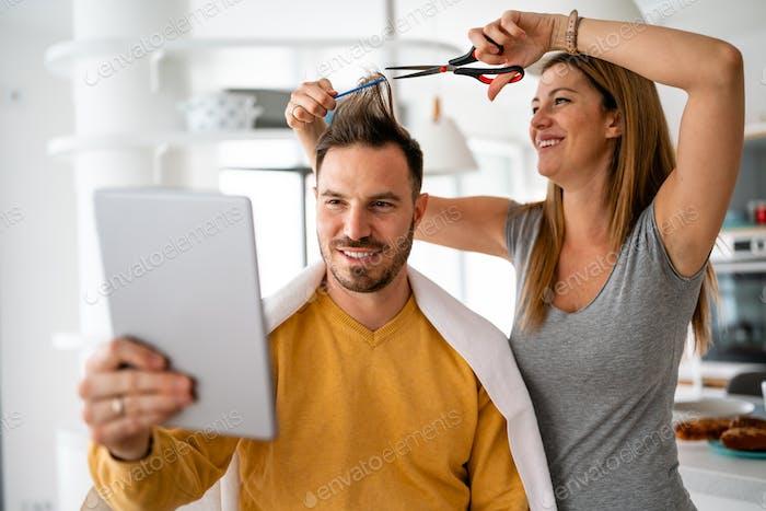 Self hair care during quarantine. Couple having hair cut at home isolation coronavirus pandemic