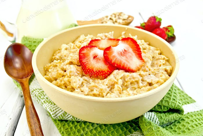 Oatmeal with strawberries on light board