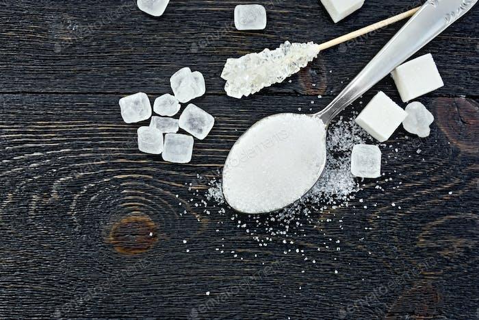 Sugar white in spoon on board top