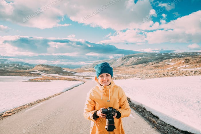 Aurlandsfjellet, Norway. Young Happy Woman Tourist Traveler Photographer Taking Pictures Photos Of