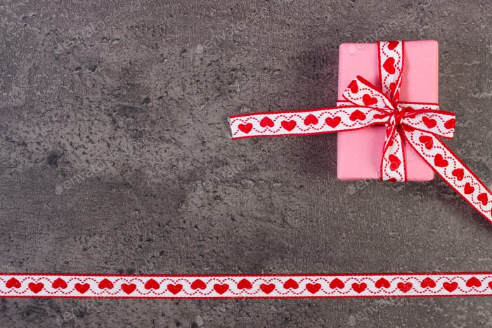 Wrapped gift with ribbon for Valentines Day, copy space for text
