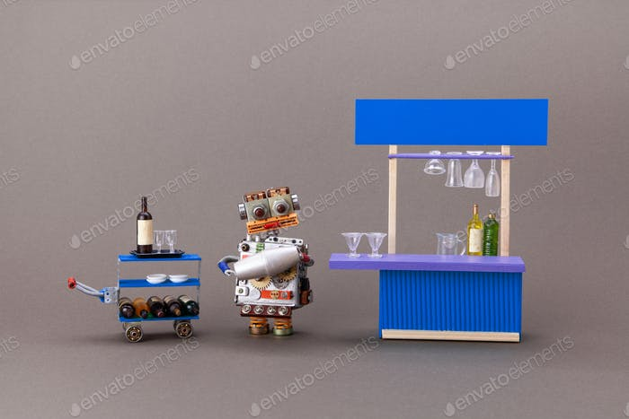 Robotic toy barman is waiting for guests. restaurant business automation concept