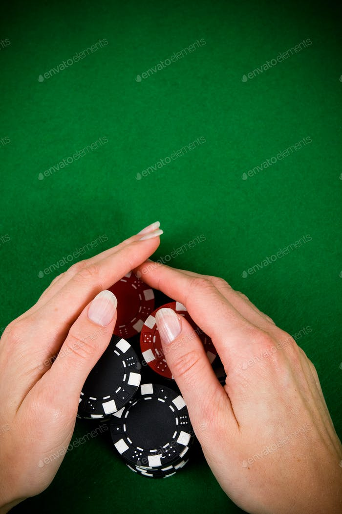 Female hand and poker chips