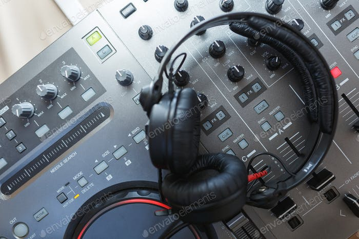 DJ Mixer with headphones.